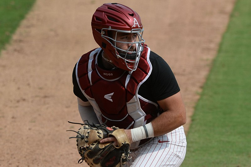 Arkansas catcher Casey Opitz fields a throw from the outfield Friday, Sept. 18, 2020, during practice at Baum-Walker Stadium in Fayetteville