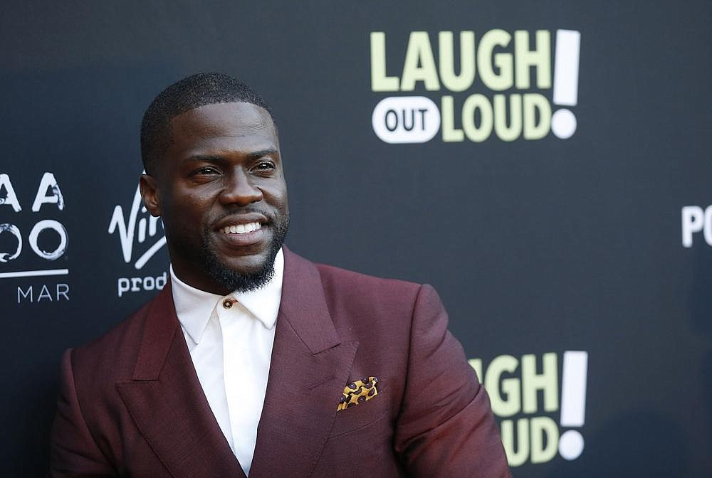 "In this Aug. 3, 2017 file photo, Kevin Hart poses at Kevin Hart's ""Laugh Out Loud"" new streaming video network launch event at the Goldstein Residence in Beverly Hills, Calif.  