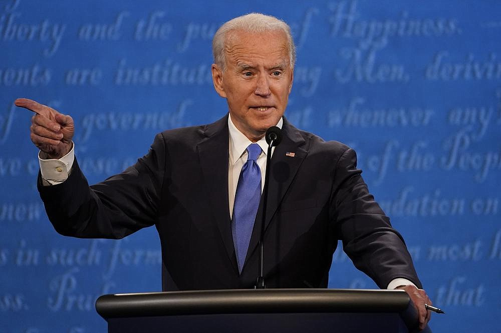 """Former Vice President Joe Biden said Thursday night that President Donald Trump's divisive approach hindered the nation's response to the pandemic. """"I don't look at this in the way he does — blue states and red states,"""" Biden said. (AP/Julio Cortez)"""