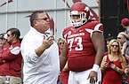 In this Sept. 5, 2015 photo, then-Arkansas offensive line coach Sam Pittman (left) speaks to Sebastian Tretola (73) during warmups before an NCAA college football game against UTEP at Donald W. Reynolds Razorback Stadium in Fayetteville. (AP Photo/Samantha Baker)