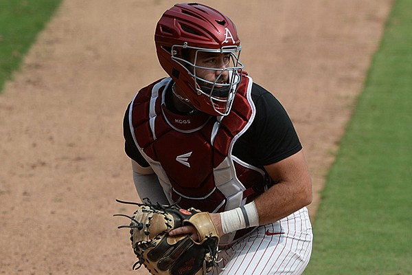 Arkansas catcher Casey Opitz fields a throw from the outfield Friday, Sept. 18, 2020, during practice at Baum-Walker Stadium in Fayetteville.