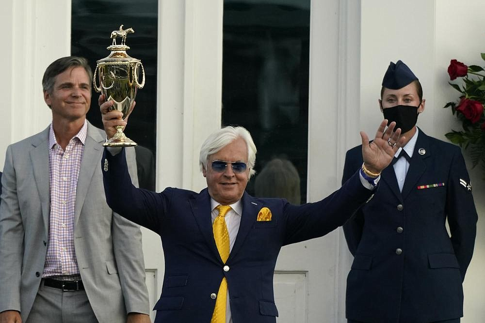 Trainer Bob Baffert holds the trophy after John Velazquez rode Authentic to victory in the 146th running of the Kentucky Derby at Churchill Downs, Saturday, Sept. 5, 2020, in Louisville, Ky. (AP Photo/Jeff Roberson)