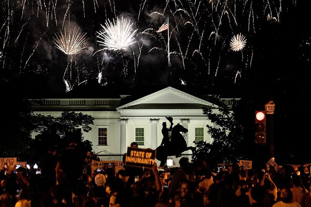 Protesters watch a fireworks display above the White House after President Donald Trump accepted the Republican presidential nomination during the final night of the Republican National Convention, in Washington, on Aug. 27. The election has become a referendum on the soul of the nation, suggesting that in an increasingly secular country, voting has become a reflection of one's individual morality — and that the outcome hinges in part on spiritual and philosophical questions that transcend politics. (The New York Times/Erin Schaff)