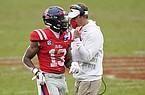 Ole Miss head coach Lane Kiffin, right, confers with wide receiver Braylon Sanders (13) during the second half of an NCAA college football game against Auburn in Oxford, Miss., Saturday Oct. 24, 2020. (AP Photo/Rogelio V. Solis)