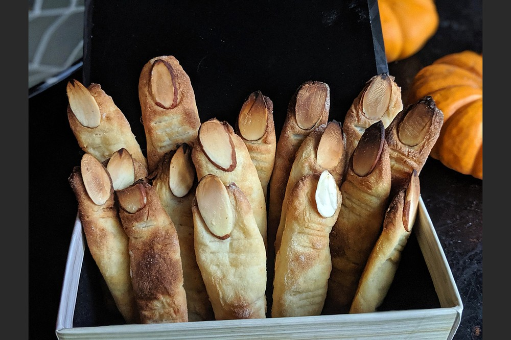 The secret ingredient in these almond-topped witches fingers? Mashed potatoes. (TNS/Pittsburgh Post-Gazette/Gretchen McKay)
