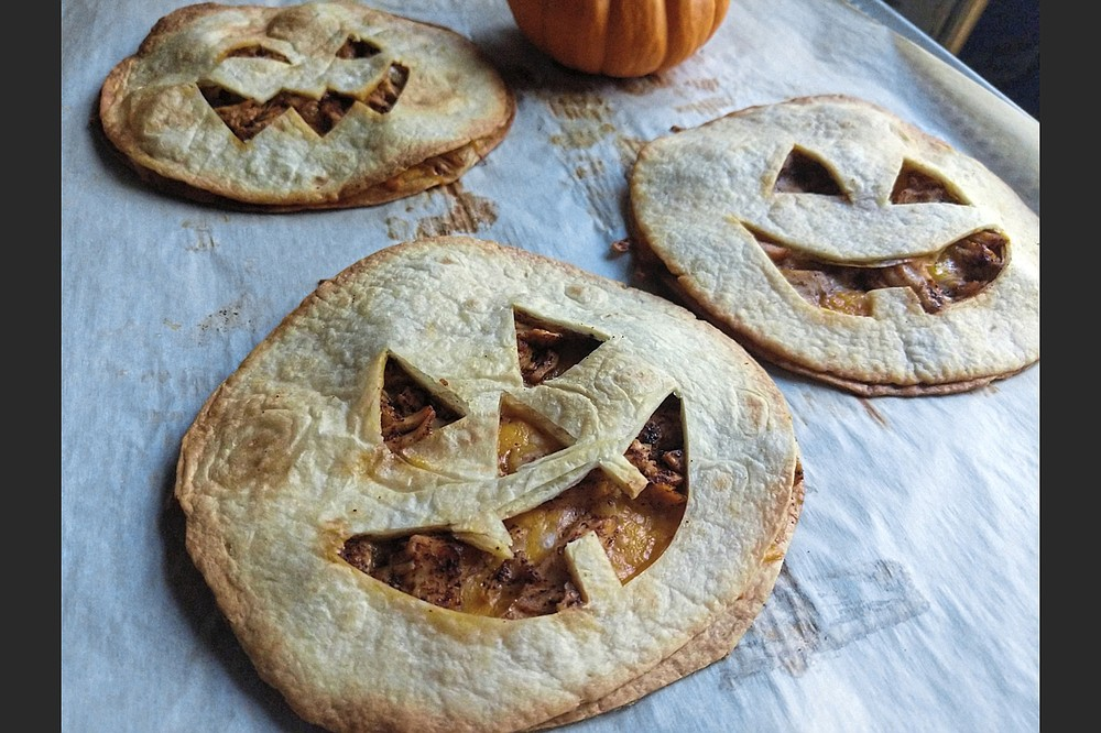 Stuffed with chicken and cheese, Jack-O'-Lantern Quesadillas make a quick and easy dinner on Halloween. (TNS/Pittsburgh Post-Gazette/Gretchen McKay)