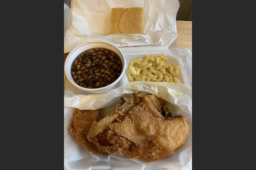 We got black-eyed peas, mac and cheese and cornbread with our fried chicken in a lunch plate from David's Family Kitchen. (Arkansas Democrat-Gazette/Eric E. Harrison)