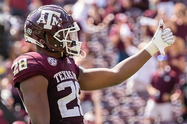 Texas A&M running back Isaiah Spiller (28) gestures during an NCAA college football game against Florida, Saturday, Oct. 10, 2020. in College Station, Texas. (AP Photo/Sam Craft)