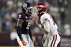 Texas A&M defensive back Leon O'Neal Jr. (9) reacts after tackling Arkansas quarterback Feleipe Franks (13) during the first quarter of an NCAA college football game Saturday, Oct. 31, 2020, in College Station, Texas. (AP Photo/Sam Craft)