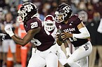 Texas A&M quarterback Kellen Mond (11) rushes against Arkansas during the first quarter of an NCAA college football game Saturday, Oct. 31, 2020, in College Station, Texas. (AP Photo/Sam Craft)
