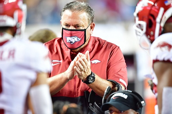 Arkansas coach Sam Pittman claps on the Razorbacks' sideline during a game against Texas A&M on Oct. 31, 2020 in College Station, Texas.