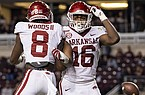 Arkansas wide receiver Treylon Burks (16) reacts with teammate Mike Woods (8) after scoring a touchdown against Texas A&M during the second half of an NCAA college football game, Saturday, Oct. 31, 2020, in College Station, Texas. (AP Photo/Sam Craft)