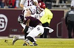 Arkansas tight end Hudson Henry (82) is tackled by Texas A&M defensive back Leon O'Neal Jr. (9) after catching a pass during the first half of an NCAA college football game, Saturday, Oct. 31, 2020, in College Station, Texas. (AP Photo/Sam Craft)