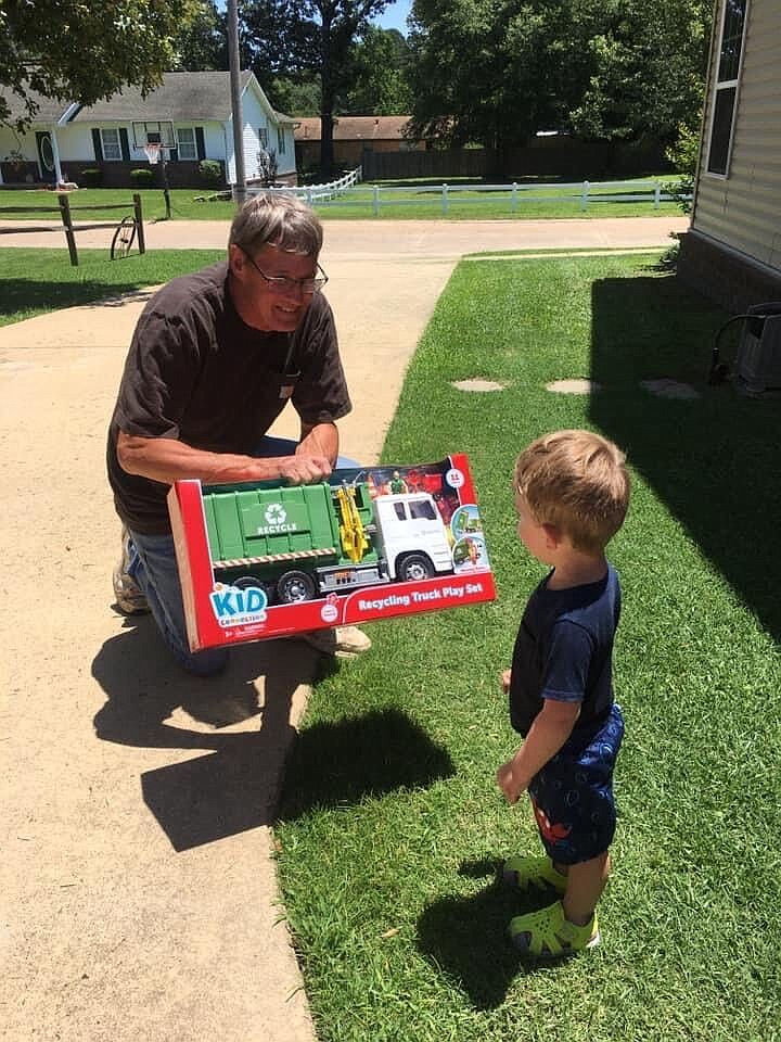Earlier this year, after greeting sanitation workers for the City of El Dorado as they stopped by his grandmother's house for trash pick-up, Myles Rigdon was surprised with his own toy garbage truck by Tim Zilks, a sanitation worker for the City of El Dorado. (Contributed)