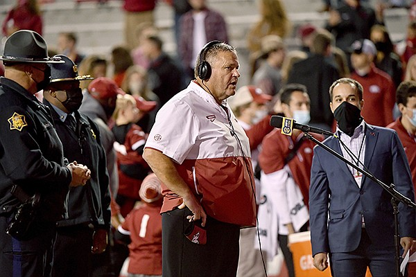 Arkansas coach Sam Pittman does his interview following the team's 24-13 win over Tennessee in an NCAA college football game Saturday, Nov. 7, 2020, in Fayetteville. (AP Photo/Michael Woods)