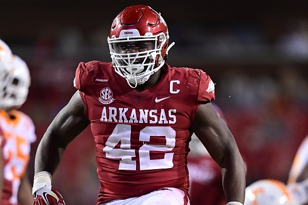 Arkansas defensive tackle Jonathan Marshall celebrates after making a tackle during a game against Tennessee on Nov. 7, 2020 in Fayetteville.