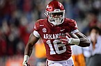 Arkansas receiver Treylon Burks runs for a touchdown during a game against Tennessee on Saturday, Nov. 7, 2020, in Fayetteville.