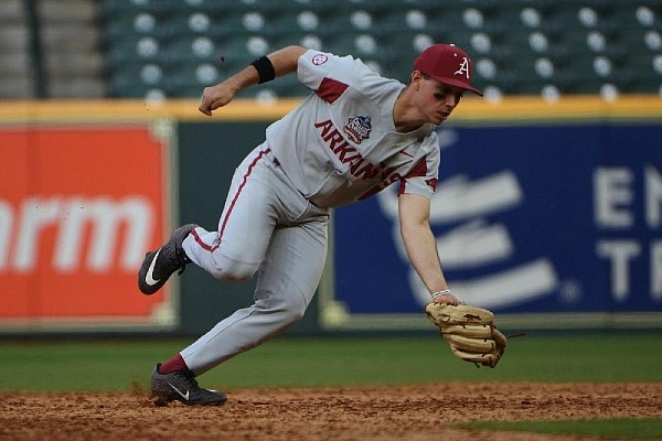 Arkansas freshman second baseman Robert Moore scoops up a ground ball during the Razorbacks' loss to Oklahoma at Minute Maid Park in Houston. (Special to the Democrat-Gazette/Chris Daigle)