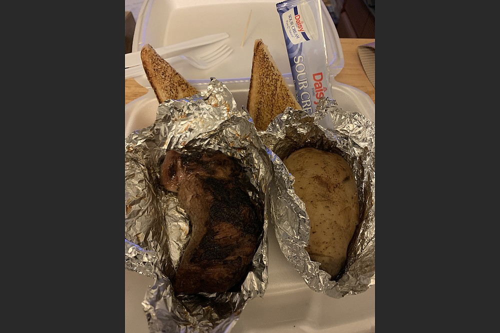 Things have been hopping at Black Angus since it reopened on its former lot spot on West Markham Street; we got a 6-ounce top sirloin and a baked potato with butter and sour cream. (Arkansas Democrat-Gazette/Eric E. Harrison)