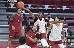 Arkansas guard JD Notae (1) shoots as guard Davonte Davis (4) blocks,Thursday, November 11, 2020 during the Red-White instrasquad basketball game at Walton Arena in Fayetteville.