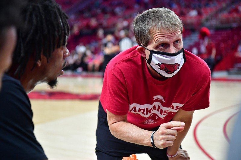 Arkansas coach Eric Musselman talks to his team before the Red-White scrimmage on Thursday, Nov. 12, 2020, in Fayetteville.