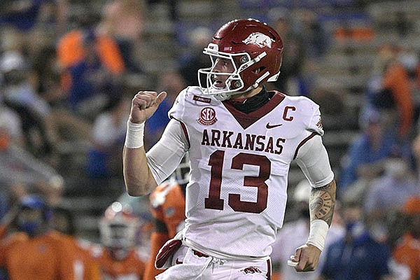 Arkansas quarterback Feleipe Franks (13) celebrates after throwing for a 47-yard touchdown to wide receiver Mike Woods during the first half of an NCAA college football game against Florida, Saturday, Nov. 14, 2020, in Gainesville, Fla. (AP Photo/Phelan M. Ebenhack)