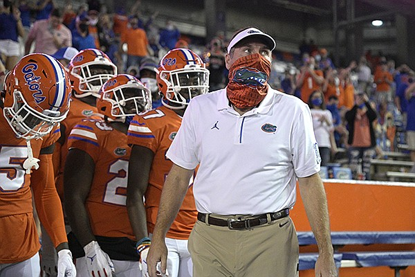 Florida head coach Dan Mullen, right, prepares to lead the team onto the field before an NCAA college football game against Arkansas, Saturday, Nov. 14, 2020, in Gainesville, Fla. (AP Photo/Phelan M. Ebenhack)