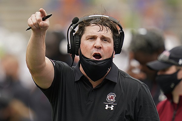 South Carolina head coach Will Muschamp has words with an official during the first half of an NCAA college football game against Florida, Saturday, Oct. 3, 2020, in Gainesville, Fla. (AP Photo/John Raoux)