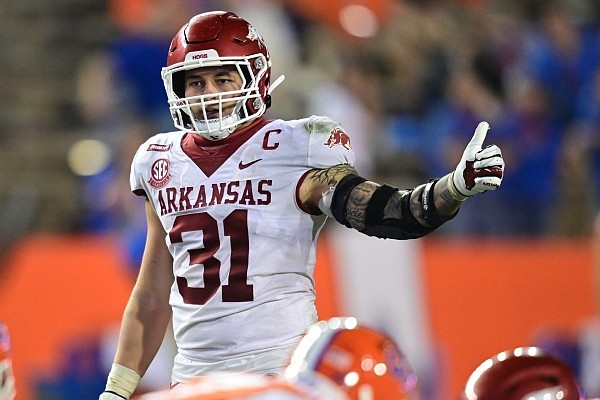 Arkansas linebacker Grant Morgan gives a thumbs up prior to a play during a game against Florida on Nov. 14, 2020, in Gainesville, Fla.