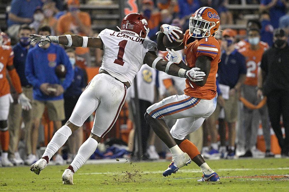 Florida's Kadarius Toney catches a pass in front of Arkansas defensive back Jalen Catalon during Saturday's game in Gainesville, Fla. More photos at arkansasonline.com/1115razorbacks/. (AP/Phelan M. Ebenhack)