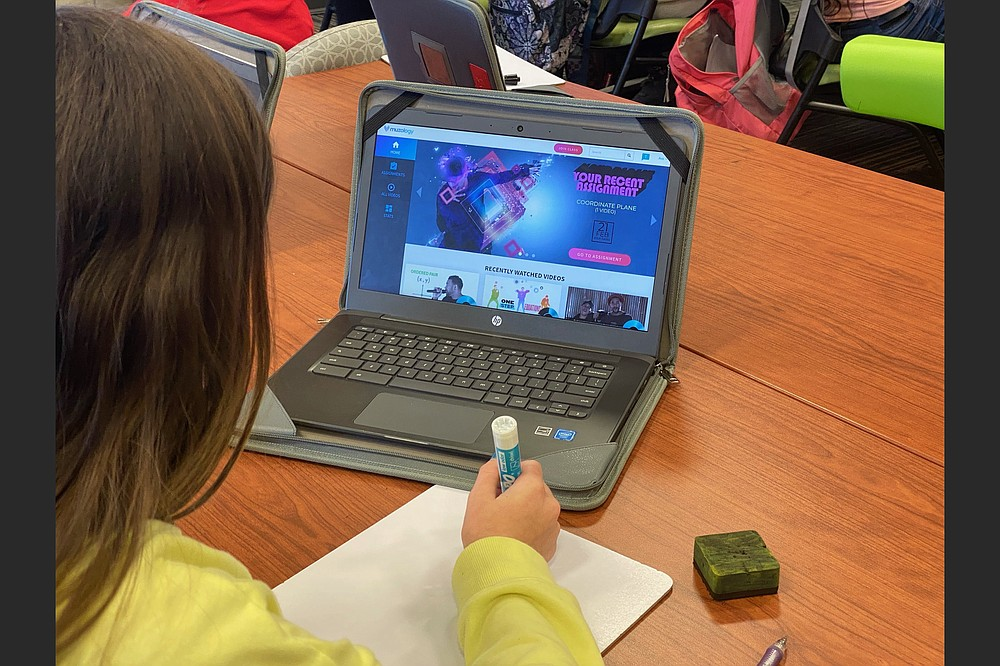 A student at Don Tyson School of Innovation in Springdale uses Muzology during class. (Special to the Democrat-Gazette)