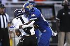 North Little Rock linebacker Davian Vayson (28) sacks Fayetteville quarterback Owen McCone (7) during the second quarter of North Little Rock's win on Friday, Sept. 11, 2020, at North Little Rock High School.