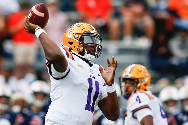 LSU quarterback TJ Finley (11) throws a pass during the first quarter of an NCAA college football game against Auburn on Saturday, Oct. 31, 2020, in Auburn, Ala. (AP Photo/Butch Dill)