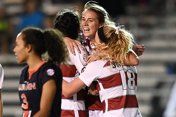 Arkansas' Kayla McKeon (center) celebrates with teammates after scoring a goal during the first half of an SEC Tournament game against Auburn on Tuesday, Nov. 17, 2020, in Orange Beach, Ala.
