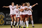 Arkansas players celebrate with freshman Emilee Hauser (facing opposite) after Hauser scored a goal during an SEC Tournament game against South Carolina on Thursday, Nov. 19, 2020, in Orange Beach, Ala.