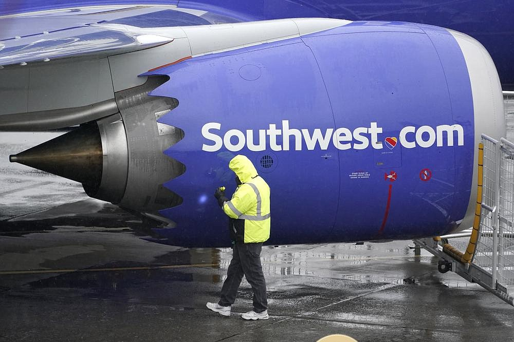 A worker Wednesday in Renton, Wash., inspects an engine on a Boeing 737 Max 8 built for Southwest Airlines. The airline's chief executive says the airline will not operate the Max until the second quarter of the new year. (AP/Ted S. Warren)