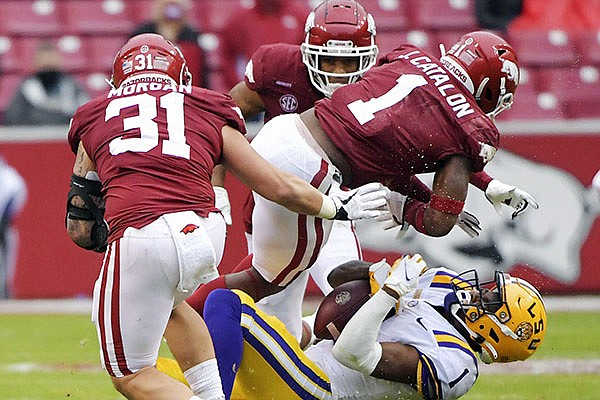 Arkansas defensive back Jalen Catalon (1) tackles LSU receiver Kayshon Boutte (1) during the second half of an NCAA college football game Saturday, Nov. 21, 2020, in Fayetteville, Ark. Catalon was called for targeting on the play and ejected from the game. (AP Photo/Michael Woods)