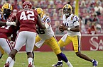LSU quarterback TJ Finley (11) looks to pass as Arkansas defensive lineman Jonathan Marshall (42) pressures him during a game Saturday, Nov. 21, 2020, in Fayetteville. (AP Photo/Michael Woods)