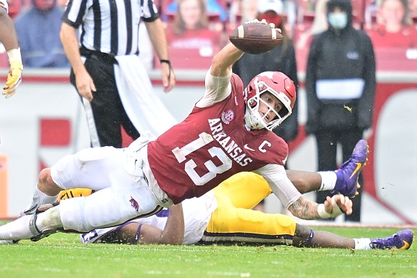 Arkansas quarterback Feleipe Franks dives in an attempt to gain a first down during a game against LSU on Nov. 21, 2020, in Fayetteville.