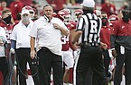 Arkansas coach Sam Pittman looks toward referee Marc Curles during a game against LSU on Saturday, Nov. 21, 2020, in Fayetteville.
