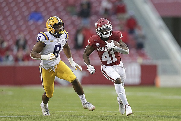 Arkansas receiver T.J. Hammonds (41) runs with the ball during a game against LSU on Saturday, Nov. 21, 2020, in Fayetteville.