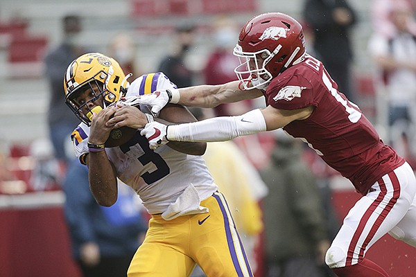 LSU running back Tyrion Davis-Price (3) attempts to catch a pass as Arkansas cornerback Hudson Clark defends during a game Saturday, Nov. 21, 2020, in Fayetteville.