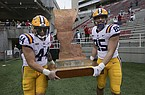 LSU players Tory Carter (44) and Nick Storz (85) carry The Boot after defeating Arkansas 27-24 on Saturday, Nov. 21, 2020, in Fayetteville.