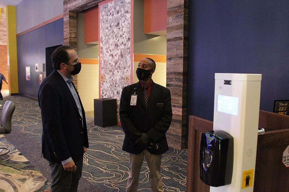 Carlton Saffa (left) talks with Sedearius Litzseg, a security official with Saracen Casino Resort, at the temperature check station that all patrons must pass through for screening before entering the gambling floor.  (Pine Bluff Commercial/Dale Ellis)