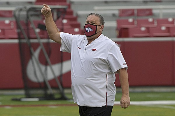 Arkansas head coach Sam Pittman with his team before the start of the Razorbacks game against LSU during an NCAA college football game Saturday, Nov. 21, 2020, in Fayetteville. (AP Photo/Michael Woods)