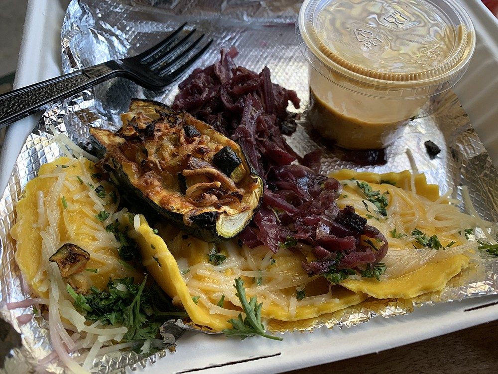 Brave New Restaurant's lunchtime Lobster Ravioli came with purple cabbage and a zucchini chunk topped with bacon and bell peppers. (Arkansas Democrat-Gazeette/Eric E. Harrison)