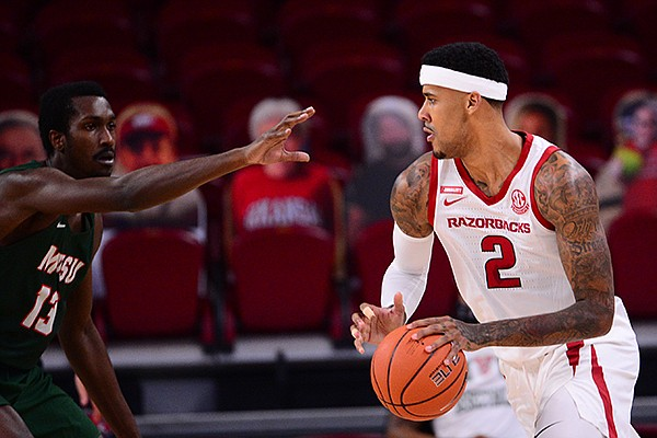 Arkansas' Vance Jackson (2) is guarded by Mississippi Valley State's Ronald Williams (13) during a game Wednesday, Nov. 25, 2020, in Fayetteville.