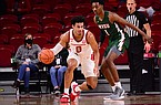Arkansas forward Justin Smith (0) is guarded by Mississippi Valley State guard Perry Alexander (1) during a game Wednesday, Nov. 25, 2020, in Fayetteville.