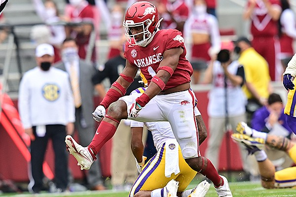 Arkansas safety Jalen Catalon (1) celebrates a tackle during a game against LSU on Saturday, Nov. 21, 2020, in Fayetteville.