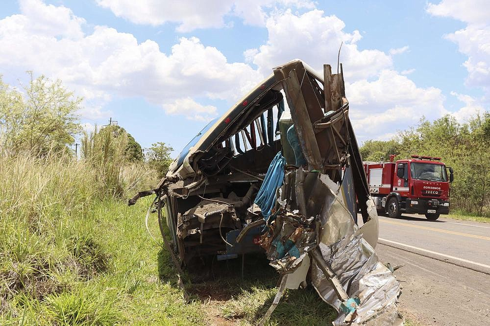 The wreckage of a bus that was carrying employees of a textile company remains on the shoulder of a road Wednesday in the municipality of Taguai, near of Sao Paulo, Brazil. (AP/Juliano Oliveira)